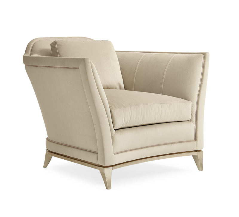 Bend the Rules Chair with beige upholstery and flared arms from Caracole