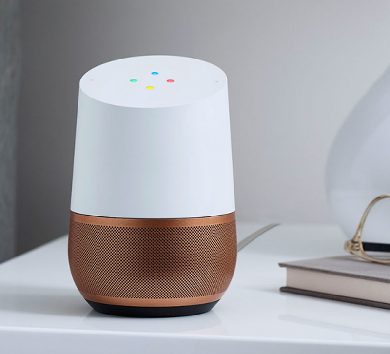 Google Home speaker with copper base sitting on desk