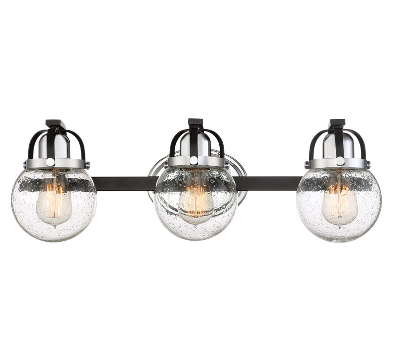 Piermont three-light Bath Light with seeded glass surrounding three Edison bulbs from Quoizel