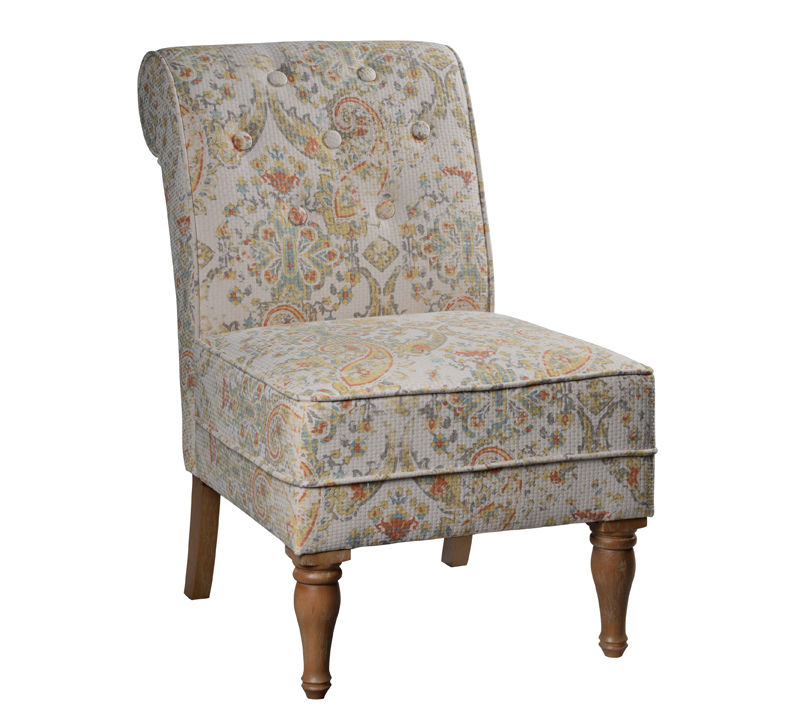 Lily Chair with carved front legs, a rounded back, buttons and a distressed floral pattern fabric from Forty West Designs