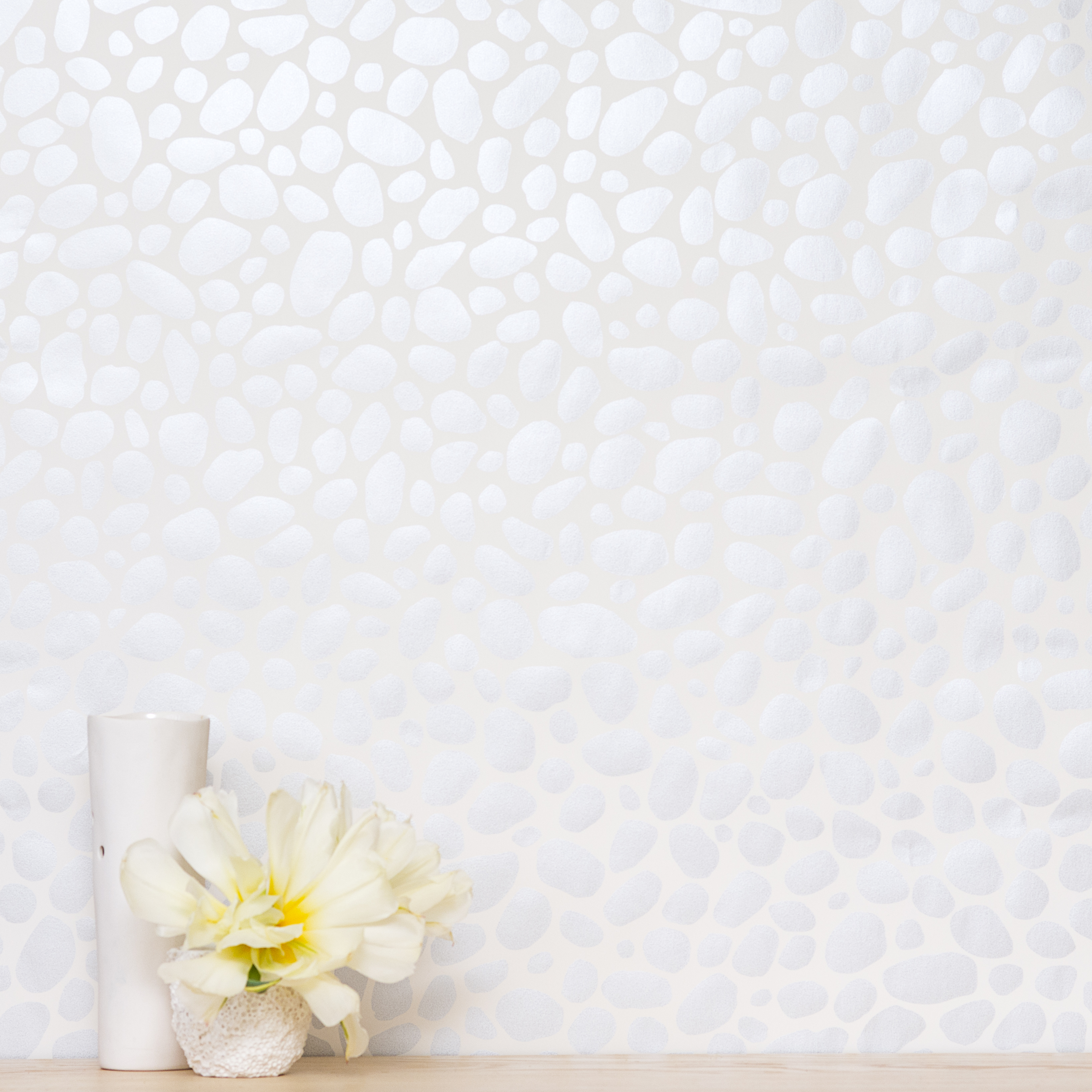 Hoya wallpaper with silver on a cream backdrop from Juju