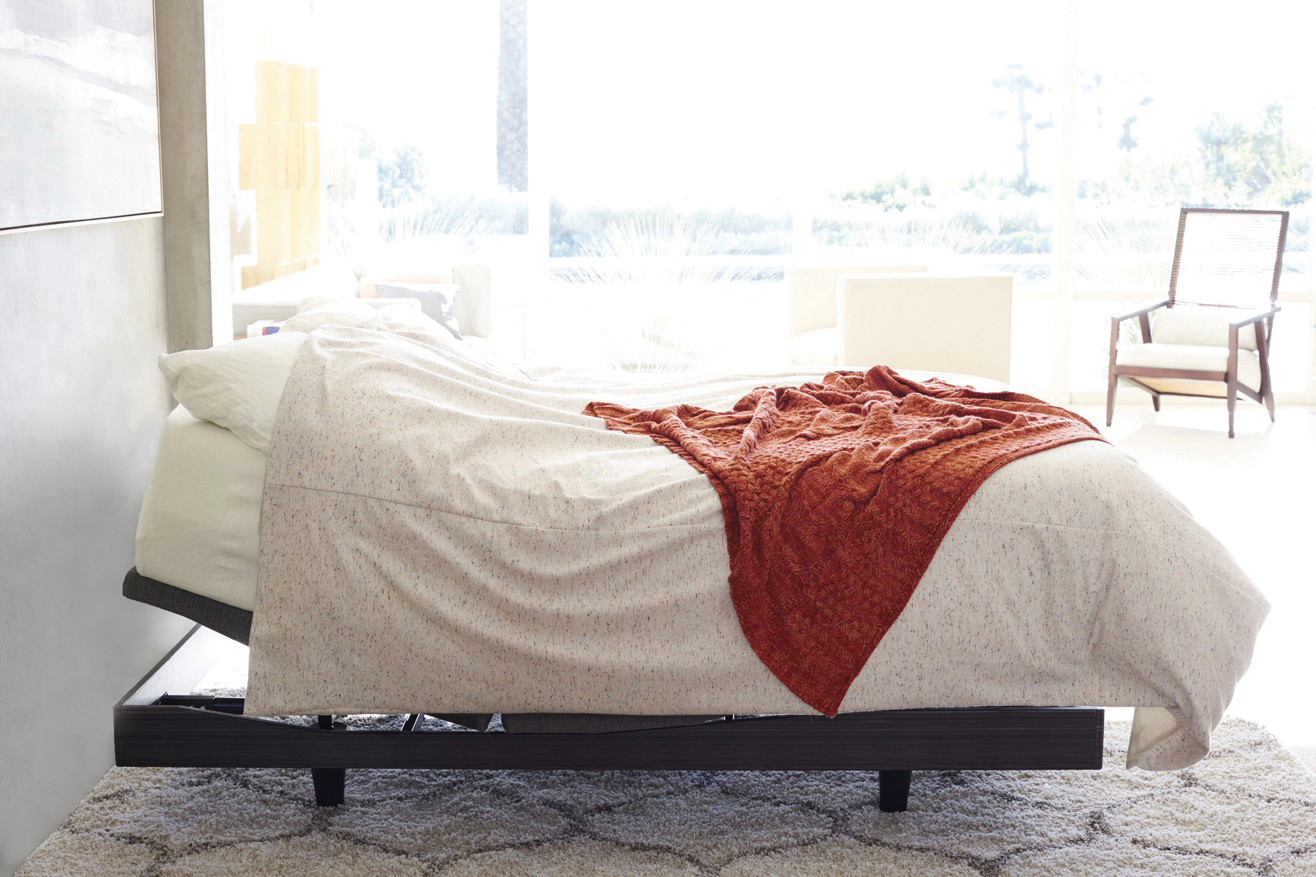 9T adjustable bed with white sheets from Reverie