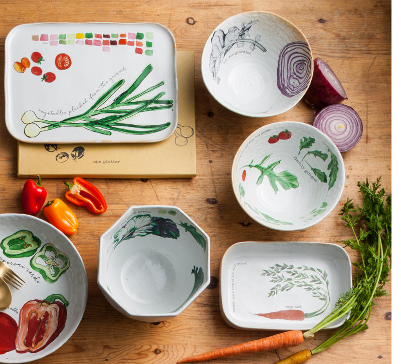 Plates and bowls with vegetables printed on them from Rosanna