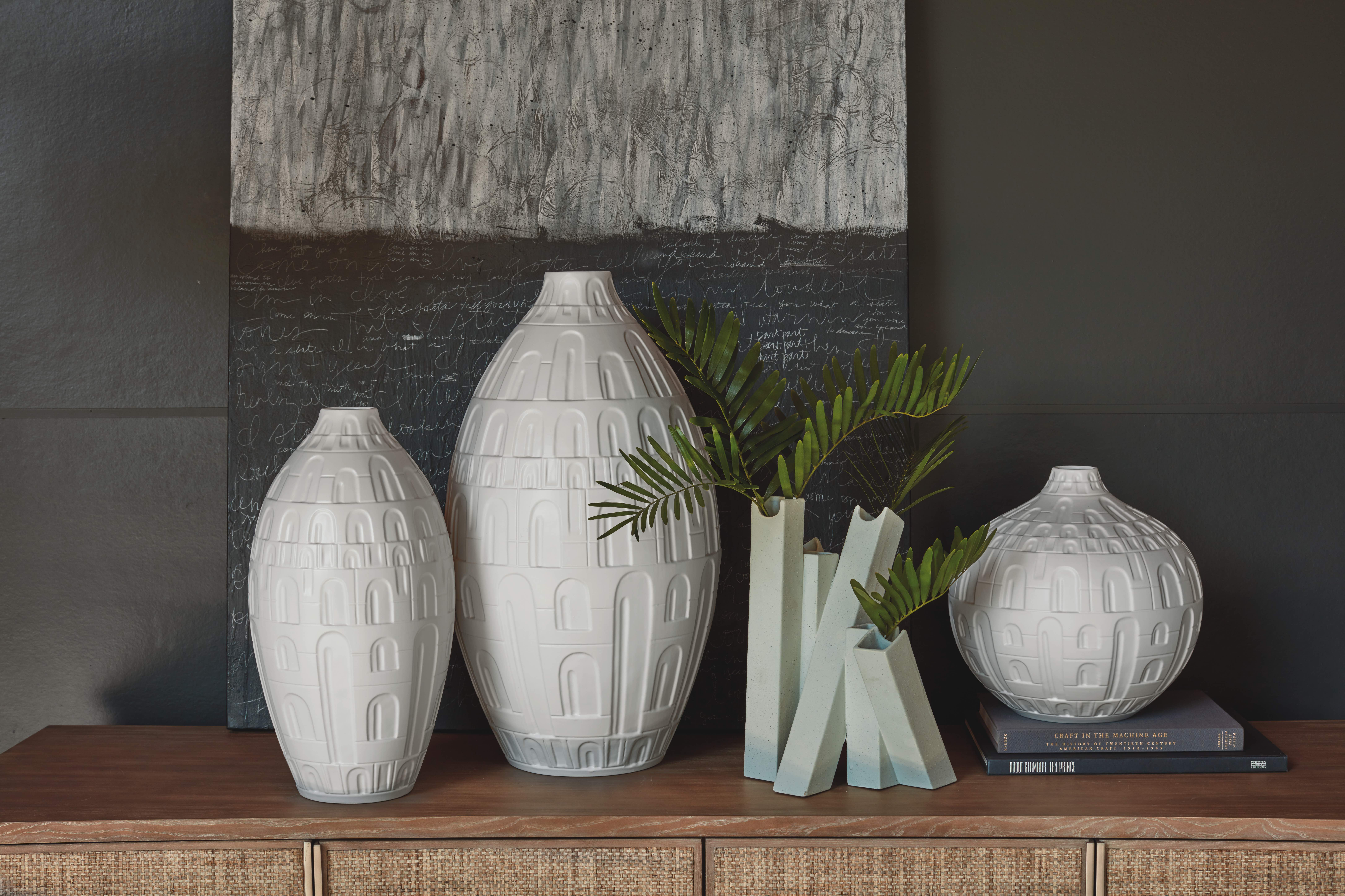 Hand-cut Coliseum Collection vases in white from Studio A Home