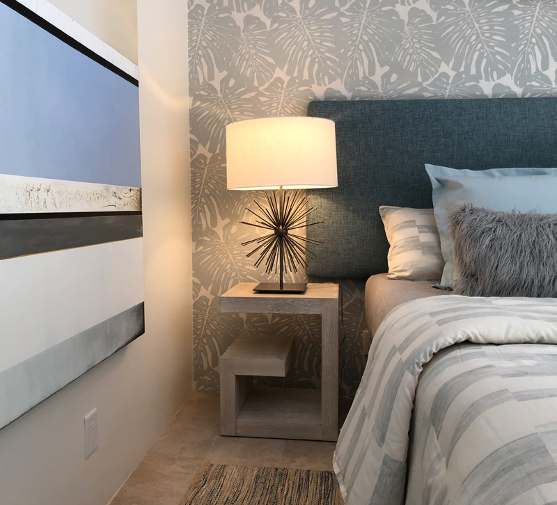 Gray and blue bedroom with table lamp on nightstand