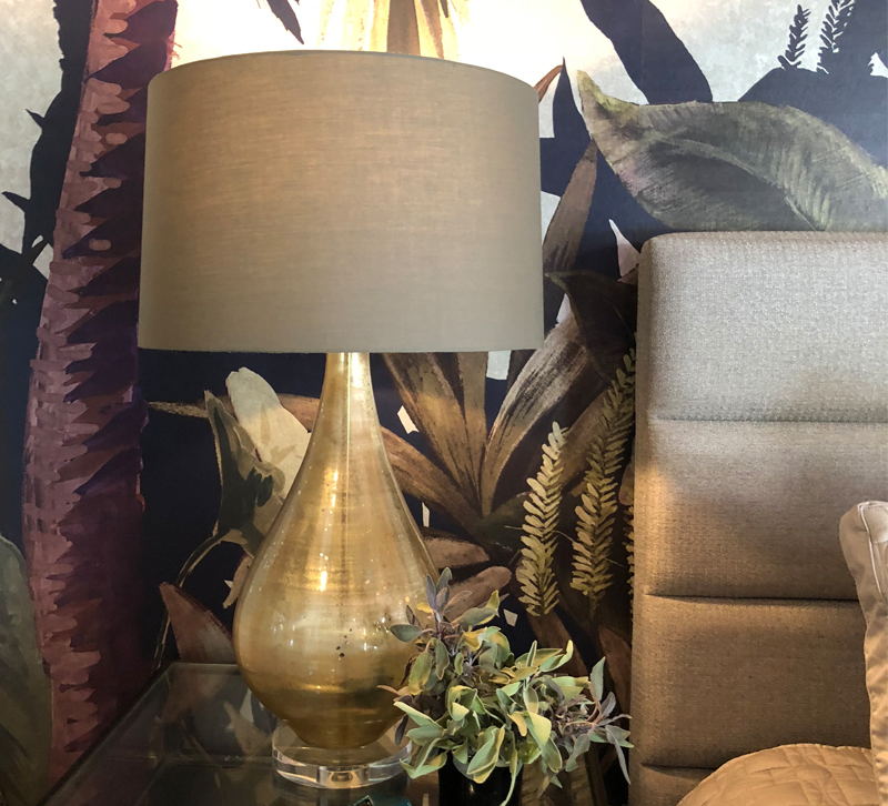 Gold table lamp on bedside table