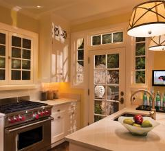 Kitchen with yellow walls and a pendant fixture