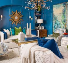 Inside IBB Fine Furnishings' showroom with blue walls and beige sofas and chairs
