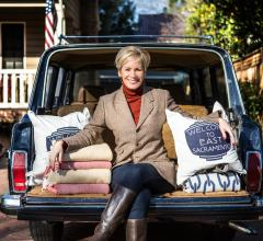Kerrie Kelly sits on the back of her car with a few of her favorite products