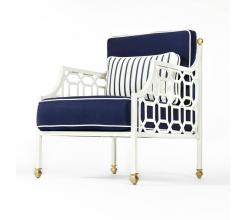 Cushion Lounge Chair in blue fabric with a white frame and brass accents from Castelle