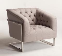 Avery Chair with slim legs and button-tufted back from Home Trends & Design