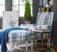 Azure chair next to bookshelf from Bunny Williams Home.