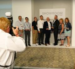 The Showroom of the Year winners line up for a photo after the awards ceremony.
