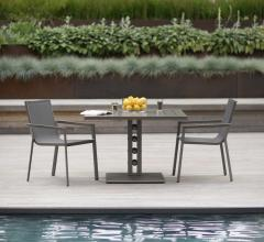 Artemis table gray table and chairs by the pool from Janus et Cie