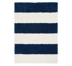 Calvin Klein Wicker Park Shag Area Rug with navy and white stripes from Nourison
