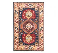 Village by Artemis Area Rug with a bo-ho design and boarder in orange, blue, red and yellow from Jaipur Living