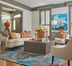 LIving room with beige couch and chairs and blue and orange rug by Global Views