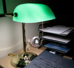 Table lamp with green shade on desk