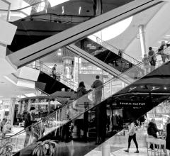 Shopping mall escalators in black and white