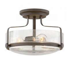 Harper Flush Mount in Oil-Rubbed Bronze with seeded glass surrounding two Edison bulbs from Hinkley Lighting