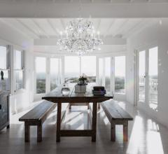 dining room with a Schonbek chandelier