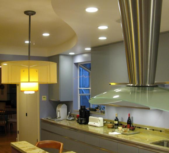 Kitchen with pendant and recessed lighting
