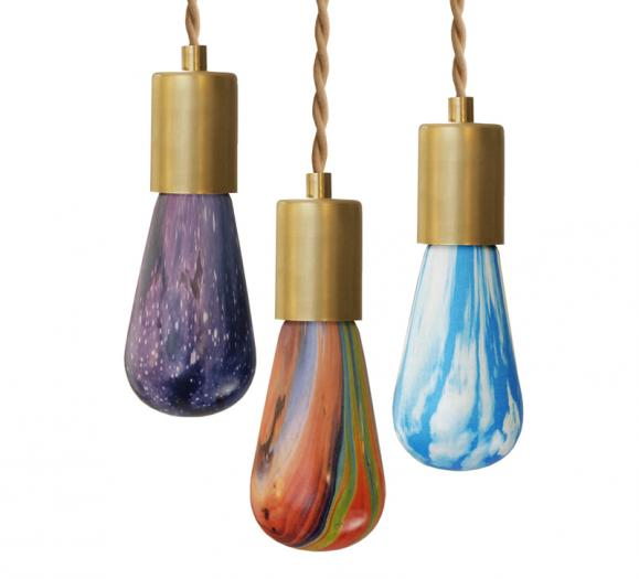 Three RELAMP printed LED bulbs in purple, multi-color and blue
