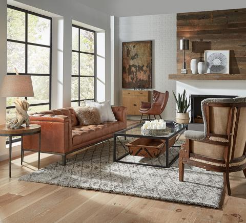 The Sarreid Cuba Brown Leather Cube X 3 Sofa features tufting on the seat, inside back and arms.