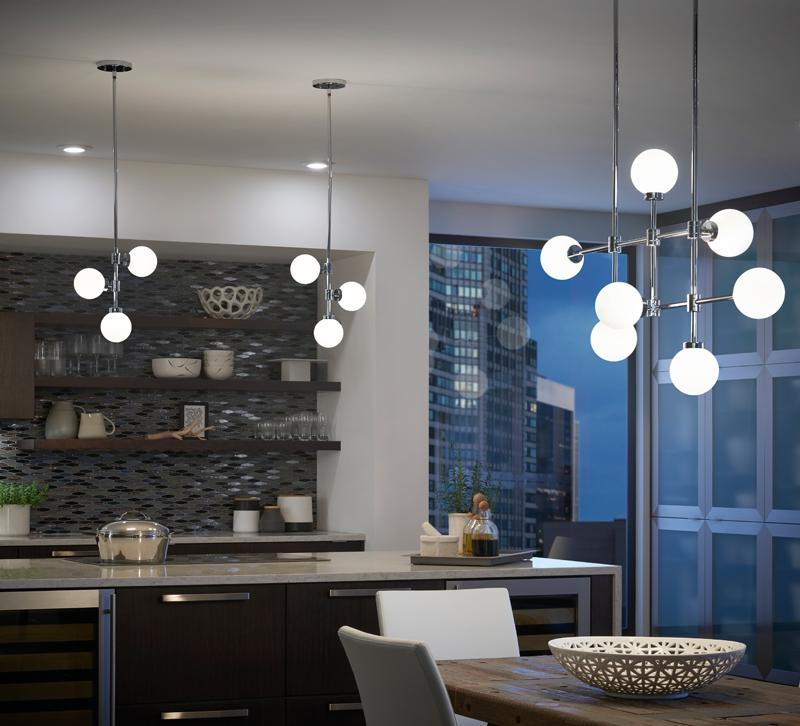Aura pendants hanging in urban kitchen and above dining room table, pendants from Kichler Lighting